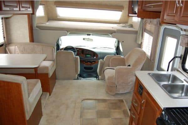 decked out rv interior with wood cabinets