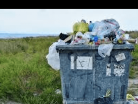 Trash can overflowing with household wastes